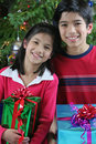 Siblings with presents Stock Photography