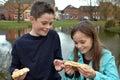 Siblings sharing pastry Royalty Free Stock Photo