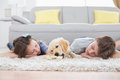 Siblings sleeping with dog on rug at home Royalty Free Stock Photo