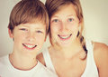 Siblings smiling younger boy elder girl Stock Photos