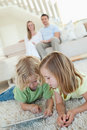 Siblings using tablet on the carpet Stock Photos