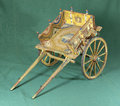 Sicilian cart old small on green background Royalty Free Stock Photo