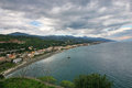 Sicilian panorama with the messina street in backg view of coastline near santalessio siculo during winter background are visible Stock Images