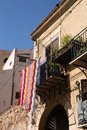 Sicily palermo island in italy colorful cloth blanket outside a balcony in old building Stock Photo