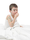 Sick boy cough in a bed Stock Photography