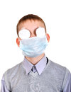 Sick boy in flu mask and bandaged eyes isolated on the white background Stock Photography