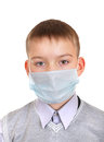 Sick boy in flu mask isolated on the white background Royalty Free Stock Photo
