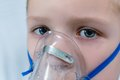 Sick boy with a mask on the face for breathing Royalty Free Stock Photo