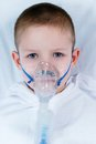 Sick boy with a mask on the face for breathing Stock Photography