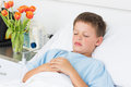 Sick boy sleeping in hospital bed