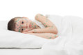 Sick boy in a white bed Stock Photography