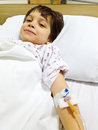 Sick child being optimistic under medical treatment and positive Royalty Free Stock Photo