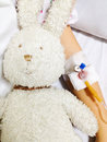 Sick child holding toy with cannula on his hand rabbit Royalty Free Stock Images