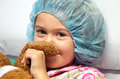 Sick child wearing surgical cap Royalty Free Stock Photo