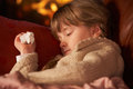 Sick Girl With Cold Resting On Sofa Royalty Free Stock Image