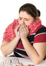 Sick girl sneezes Stock Image