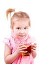 Sick little girl with chickenpox drinking tea with lemon isolated on white Royalty Free Stock Photos