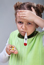 Sick little girl flu holding pills thermometer Stock Image