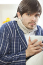 Sick man with cup tea Royalty Free Stock Image