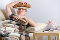 Sick man holding head on pillows concept of headache overworked pain Royalty Free Stock Images