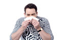 Sick man sneezing Royalty Free Stock Photo