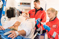 Sick patient with paramedic in ambulance treatment Stock Image