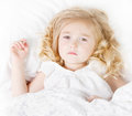 Sick or sad child in bed Stock Photography