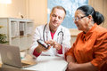 Sick senior woman having a doctor appointment Royalty Free Stock Photo