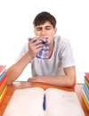 Sick student at the school desk isolated on the white background Royalty Free Stock Images