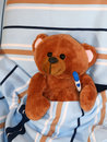 Sick teddy bear with thermometer in bed Royalty Free Stock Photo