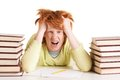 Sick and tired portrait of redhead student between two stacks of books shouting Stock Photos