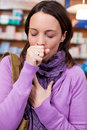 Sick woman coughing in pharmacy young is Stock Photography