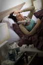 Sick woman with flu lying in bed suffering from headache Stock Image
