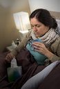 Sick woman with flu, tissue and tea Royalty Free Stock Photo