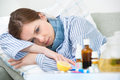 Sick woman lying in bed with high fever cold flu fever and migraine Royalty Free Stock Photo