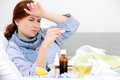 Sick woman lying in bed with high fever cold flu fever and migraine Royalty Free Stock Images
