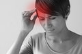 Sick woman with pain headache migraine stress hangover insomnia in casual dress hand holding head quarter view Stock Photo