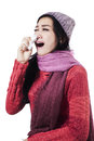 Sick woman sneezing with handkerchief isolated on white background Royalty Free Stock Photo