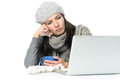 Sick woman in winter attire with laptop and tea close up tired gray working her while having cup of hot on desk isolated on white Royalty Free Stock Photo