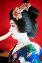 Side angle protrait of Japanese Maiko, Geisha  in beautiful cost Royalty Free Stock Photo
