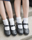 Side of asian thai girls schoolgirl student legs and feet with black shoes leather as a school uniform it is teenage education Stock Photo