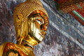 Side of buddha head a gold statue at the public temple Stock Image