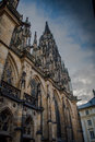 Side column of the gothic Vysehrad cathedral in Prague featuring beautiful windows and stone wall and pillars Royalty Free Stock Photo
