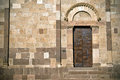 Side door old romanesque church Royalty Free Stock Images
