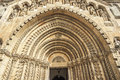 Side entrance to a gothic church. Royalty Free Stock Photo