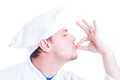 Side face of chef or cook making tasty delicious gesture Royalty Free Stock Photo