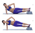 Side plank hip raise Royalty Free Stock Photo