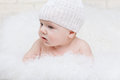 Side portrait concentrated baby white hat Stock Images