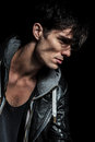Side portrait of a cool man in leather jacket Royalty Free Stock Photo