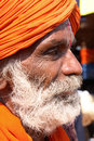Side portrait of a traditionally dressed older man in goa india Stock Photo